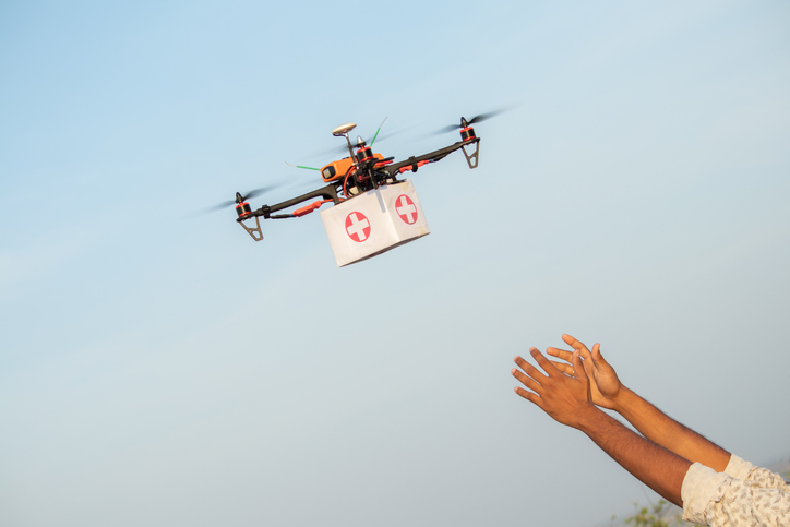 Drone Delivering First Aid Box or medicine to costumer hand during covid 19 or coronavirus lockdown   Advancing Medical Industry Logistics for Drug Transport concept.
