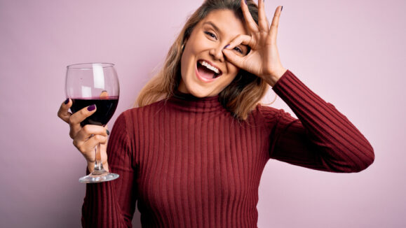 Young,Beautiful,Blonde,Woman,Drinking,Glasse,Of,Red,Wine,Over