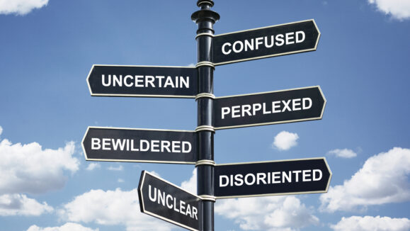 Crossroad,Signpost,Saying,Confused,,Uncertain,,Perplexed,,Bewildered,,Disoriented,,Unclear,Concept