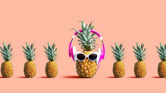 One out unique pineapple wearing headphones